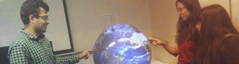 TIDESS team with globe