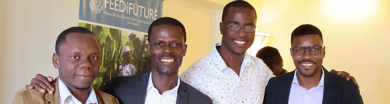 Lemane Delva, second from left, and Antonio Antoine, far right, with two attendees.