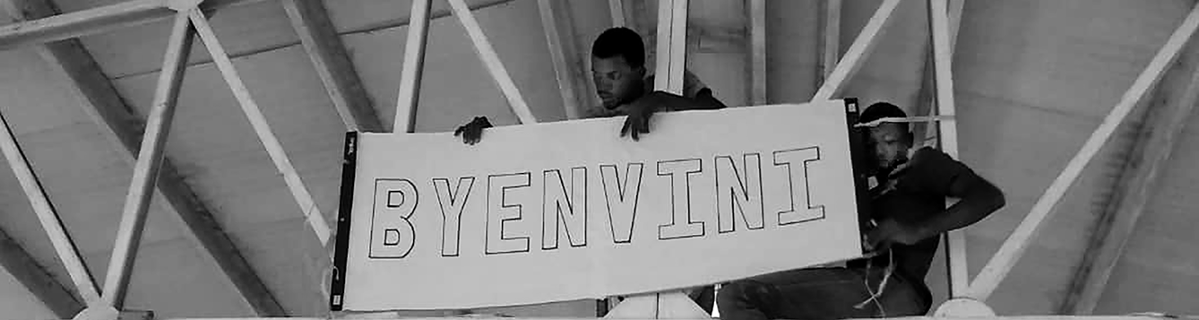 Haitian students placing Byenvini sign.