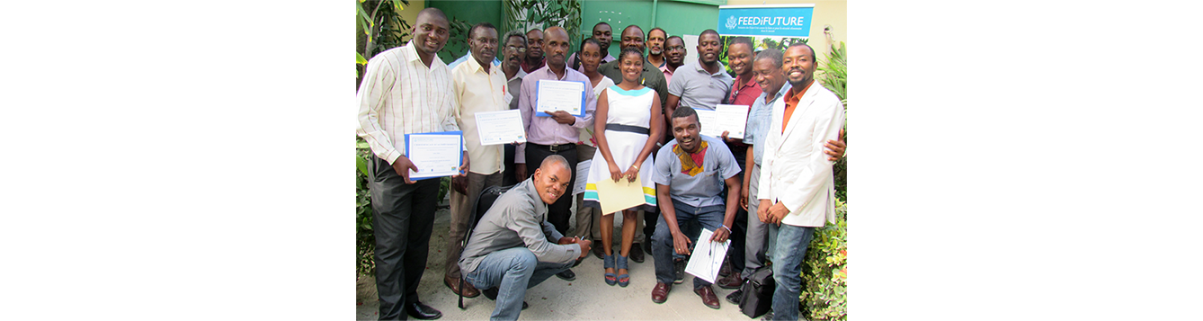 A group of Haitian faculty members gather after a training