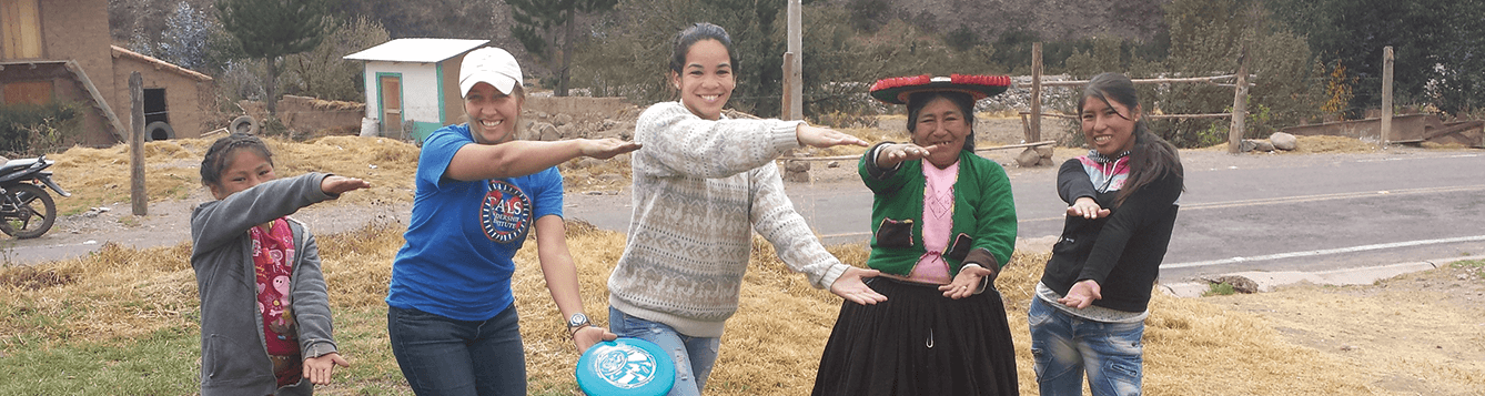 CALS female student Gator chomps with four indigenous Peruvians