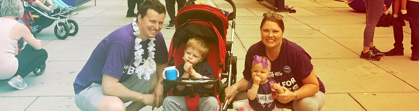 Megan (Hoot) Walker crouches with her family at the end of the March of Dimes march.