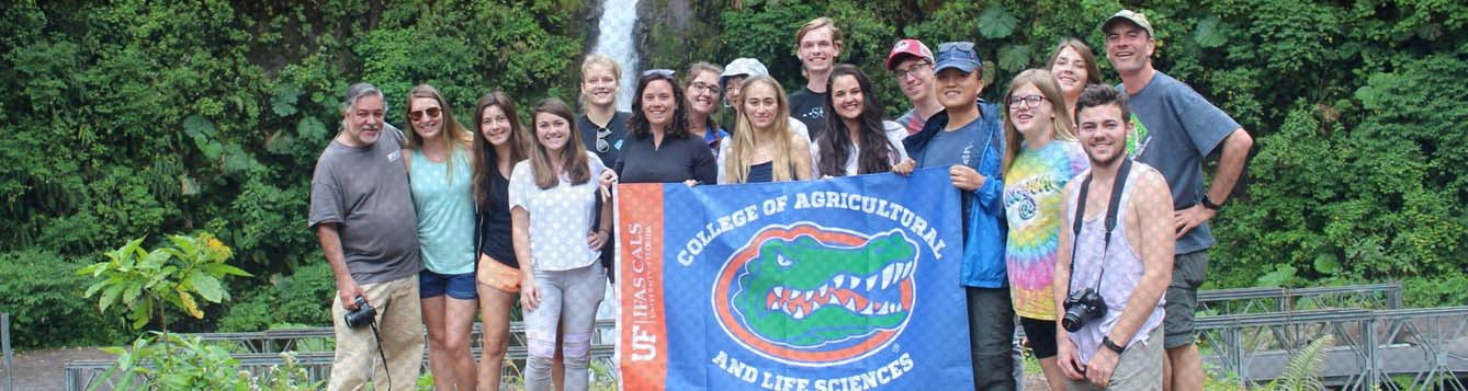 Students with College of Agricultural and Life Sciences Flag