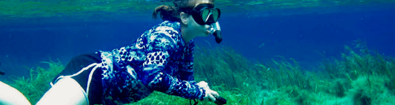 Intern Kelly Colvin snorkeling in seagrass
