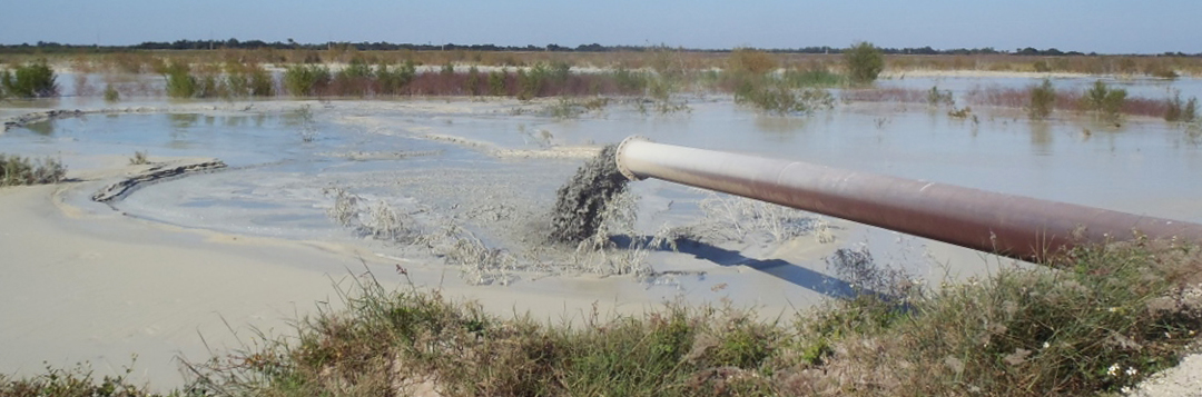 Inlet pipe depositing sand-clay mix
