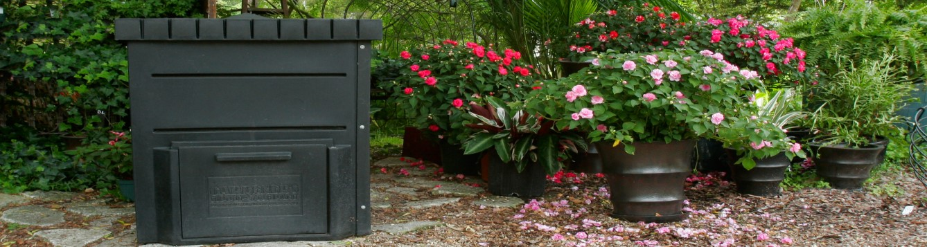 Backyard composter, flowers in pots, trees in background. UF/IFAS Photo: Thomas Wright