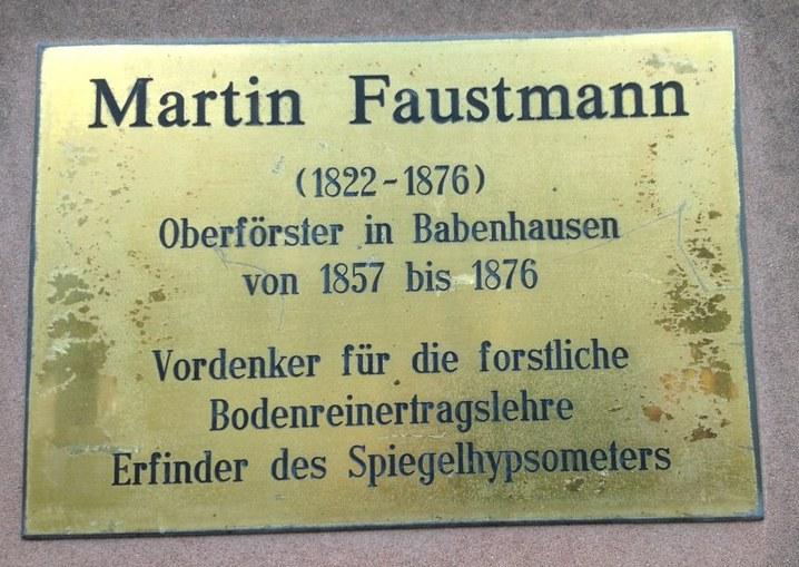 A plaque reading Martin Faustmann (1822-1876)