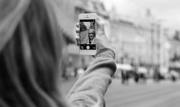 teen taking selfie