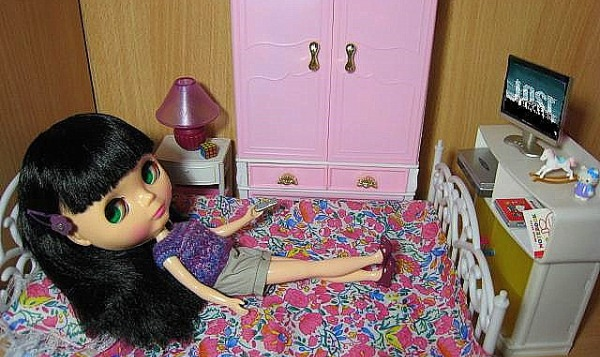 doll watching TV