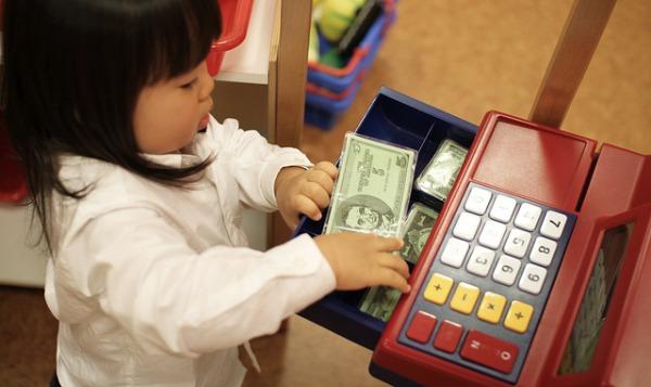 child at cash register