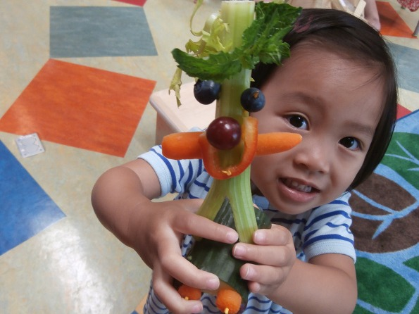 child with vegetable person