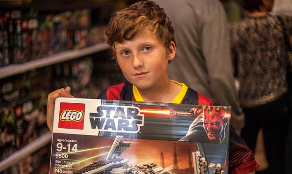 boy with lego set