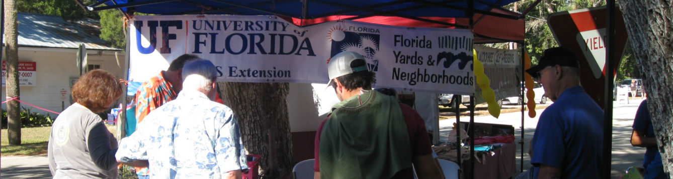 Children and adults interact with Extension Master Gardeners during annual Arts and Seafood Festival.