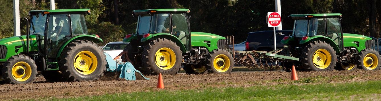 Three tractors in a farmer's field