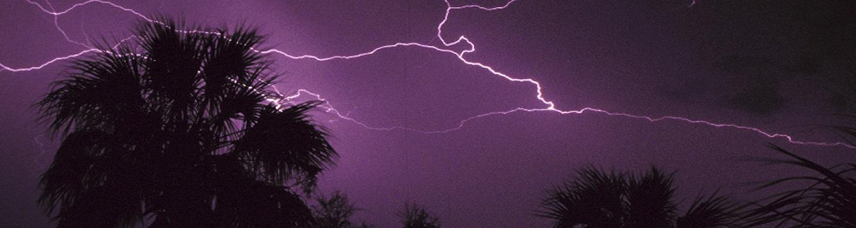 night sky torn by lightening