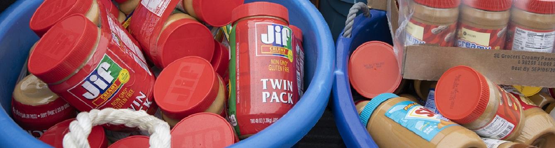 tubs full of jarred peanut butter