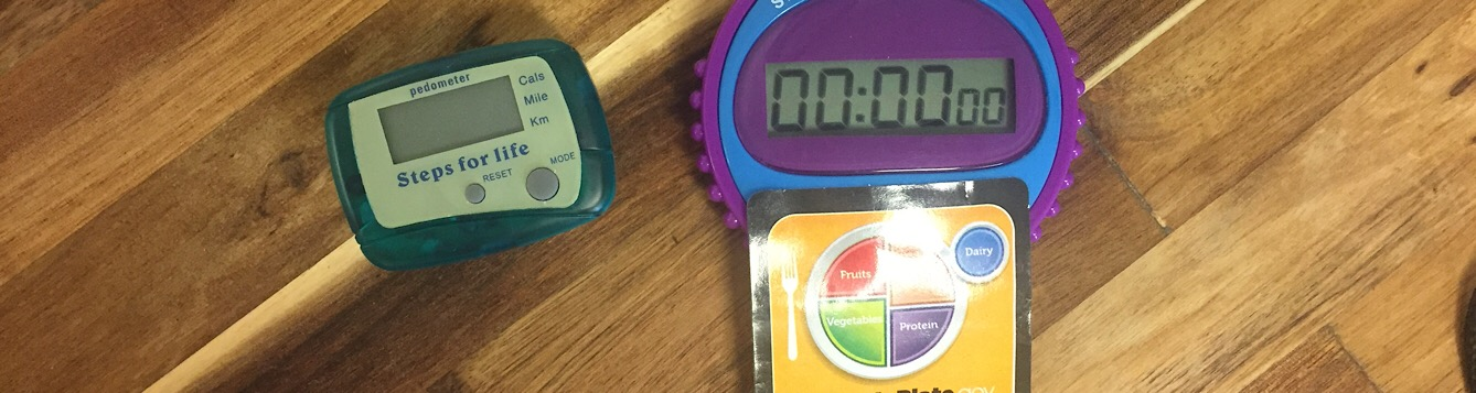 photo of a pedometer and stop watch