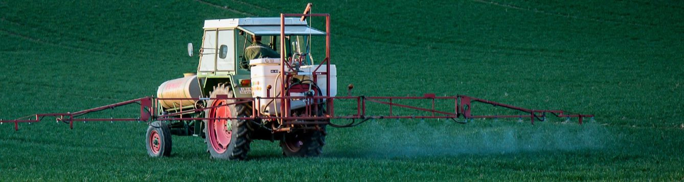 herbicide application from a tractor with boom sprayer