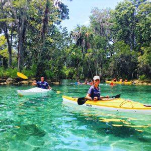 interns Alec and Kimberly kayaking in Three Sisters Springs