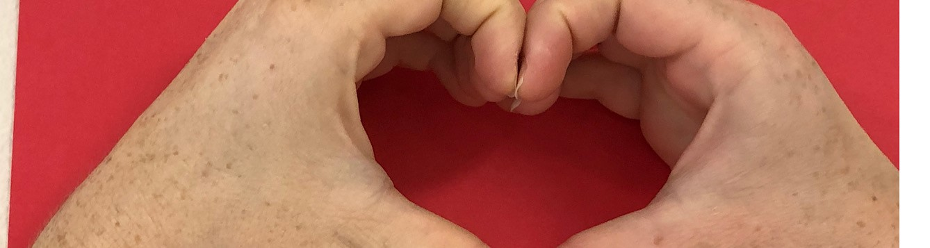 two hands making a heart
