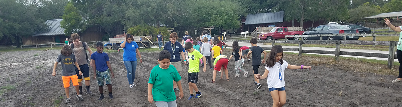 4-H Youth Planting Seeds