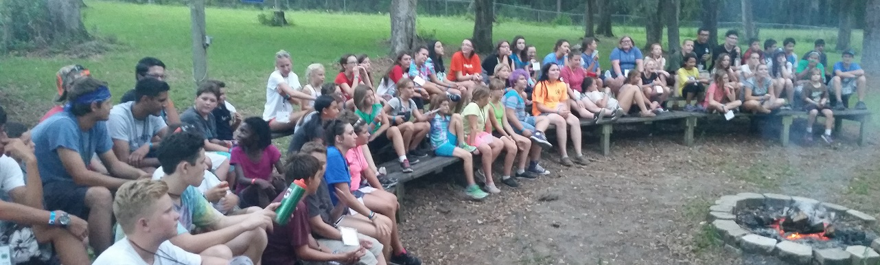 Cheery Lake Campers seated around a firepit
