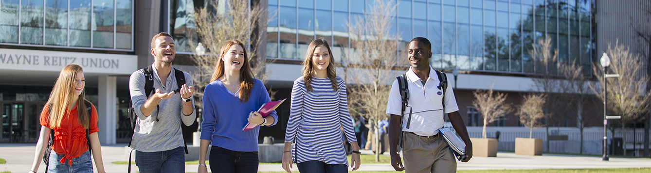Students walking on UF's campus in front of the Reitz Union. Photo taken on 01-05-17.