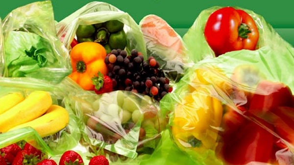 fruit and vegetables in green bag