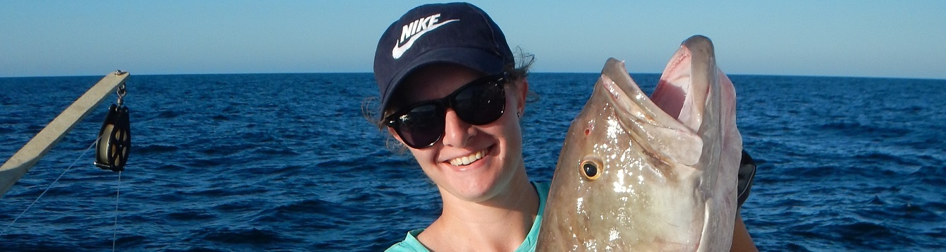 NCBS intern Courtney S holding a grouper on a FIM offshore trip