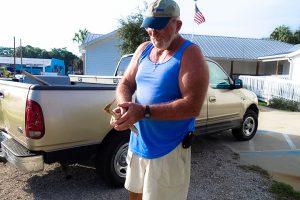 Cedar Key Bird Rescue lead volunteer Capt. Doug Maple rescuing a least bittern in Cedar Key.