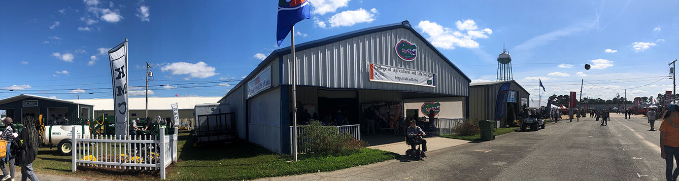 warehouse building on Sunbelt ag expo grounds, blue roof with a flag with the Florida Gators logo