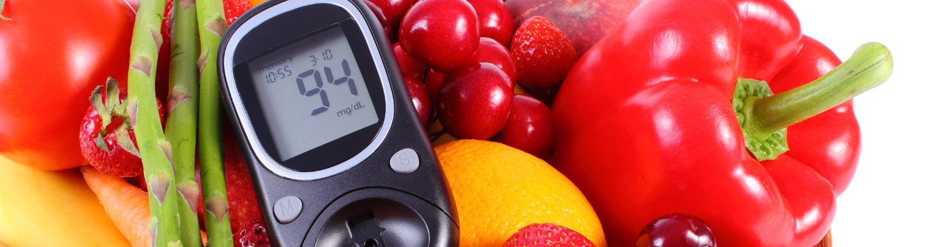 veg and fruit with glucose meter