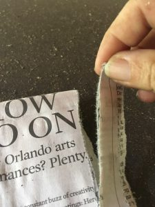 hand tearing newspaper