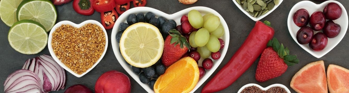 fruit vegetables and grains in heart shaped bowls
