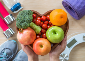 vegetables in heart shaped bowl with fitness items
