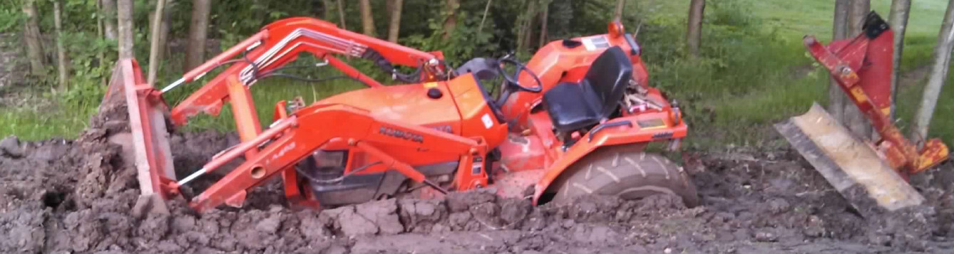 A tractor stuck in the mud