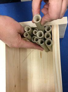 adding bamboo to a pollinator house