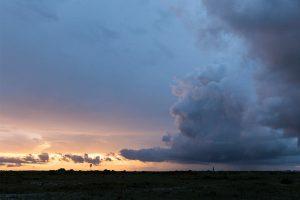 Cumulonimbus clouds on horizon