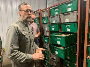 Dr. Ken Pecota standing by organized bins