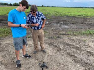 drone instructor teaching student field application in sod fleld