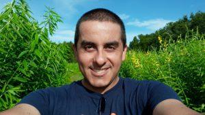 Jaime standing Inside a sunn hemp crop at the RCREC