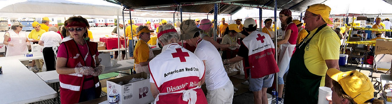 Volunteers prepare meals for storm survivors