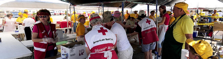 Volunteers prepare meals for storm survivors