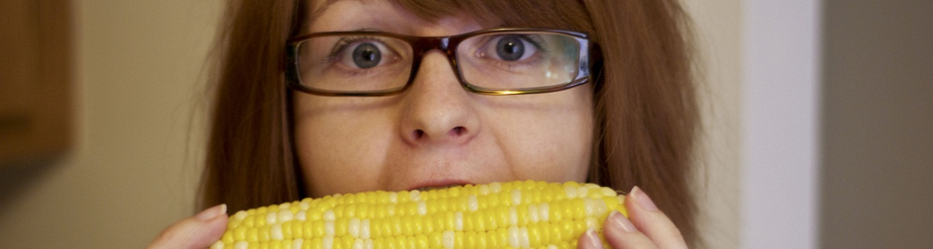 woman eats corn on the cob