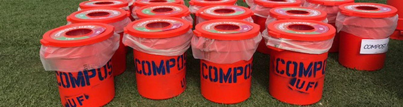 an array of compost bins waits at a rowing event