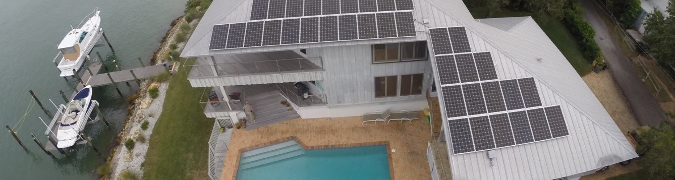 Aerial photo of Larry's home with solar panels attached to the roof
