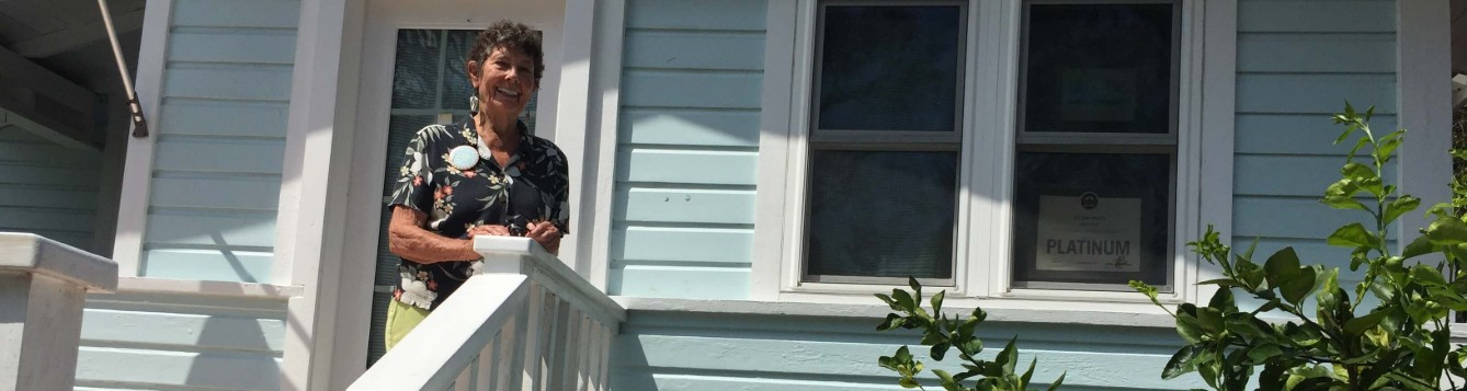 Erica Brigham standing on her front porch.