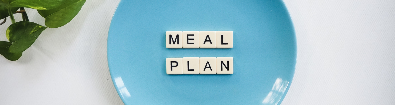 "plate with ""meal plan"" spelled out with letter tiles"