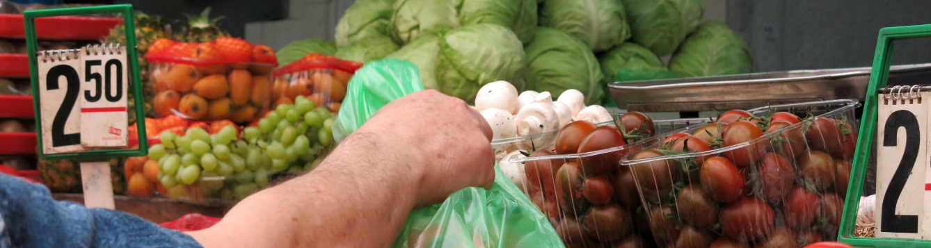 a shopper grabs for produce at a market