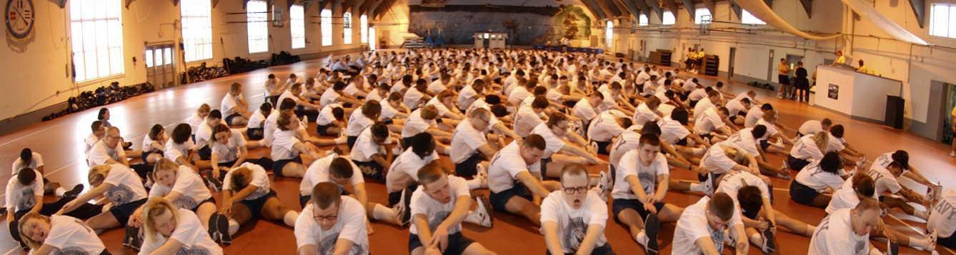 a group of men and women stretch in a mass setting